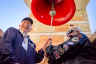 USS Arizona survivors Lauren Bruner (left) and Clarendon Hetrick ring the ship's bell at the UA's Student Union Memorial Center on Sunday. Bruner, 95, is the oldest living survivor of the sinking of the Arizona at Pearl Harbor.