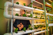 Joel Cuello of University of Arizona's BIO5 Institute and director of the Global Initiative for Strategic Agriculture in Dry Lands demonstrates his Arizona Green Box, a portable vertical farming prototype on the UA Campus.