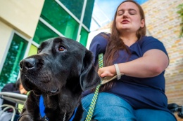 Shelby Smith and her assistance dog Picasso